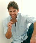 Man eating chocolate cropped